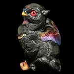 Sitting Griffin Chick Sculpture Black Sunset